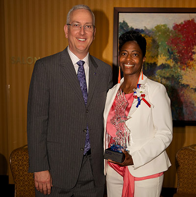 Dr. Ruth Jones, right, recently received the Wings of Excellence award from the Federal Executive Board of Cleveland. Alan Phillips, director of the NASA Safety Center, left, nominated her for the award and was on hand for the award's presentation.