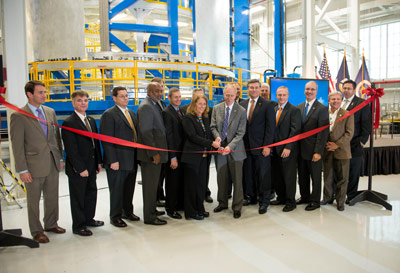 NASA, Boeing and government officials -- including William Gerstenmaier, NASA associate administrator for Human Exploration and Operations, at center, cutting the ribbon -- celebrated the unveiling of the Vertical Weld Center at Michoud.