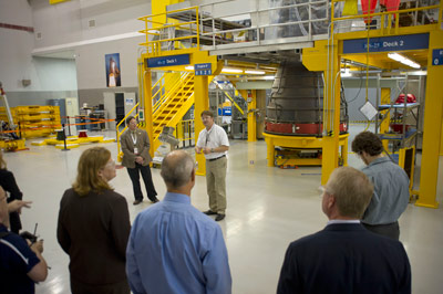 Mike Kynard, center, manager of the SLS Liquid Engines Office at the Marshall Center, talks to visitors in foreground about the RS-25 engines during a tour of the engine processing facility at Stennis. The engines will power the SLS core stage.