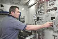 Cosmonaut Vladimir N. Dezhurov performs Pulmonary Function in Flight (PuFF) training in the Space Station Destiny laboratory mockup/trainer at NASA's Johnson Space Center's Systems Integration Facility.