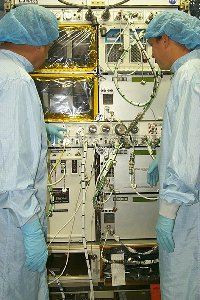 Before the STS-100 Space Shuttle mission, technicians prepared EXPRESS racks 1 and 2 for launch at the Kennedy Space Center, Fla.