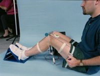 Photo description: The Hoffmann Reflex (H-Reflex) experiment seeks information on changes to the human nervous system that occur during long duration flight. In the experiment, shown being performed, a mild electrical shock will be applied to the back of a crewmember's knee.