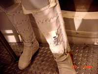 Extravehicular Activity Radiation Monitoring (EVARM) experiment badge is shown placed in a pocket in the lower left leg of an astronaut liquid cooling garment. Badges also are placed in the front torso and fabric communications cap of the spacesuit undergarment.