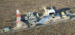 Photo description: An aerial shot of the 30-acre X-33 Flight Operations Center, located on the northeast corner of Edwards Air Force Base, Calif., shows the 250-foot-tall water tower, moveable vehicle shelter and flame trench.
