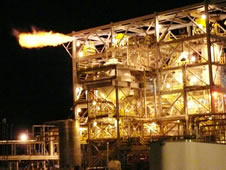Flames burst from the E-1 Test Stand as Stennis Space Center engineers perform one of dozens of shuttle gaseous hydrogen flow valve tests.