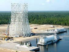 A fuel barge pulls up to a new A-3 Test Stand transfer dock during a July 9 test.