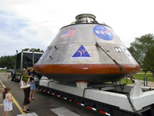 Visitors view a full-scale mockup of NASA's Orion crew exploration vehicle during its one-day display Wednesday at StenniSphere.