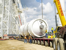 A liquid oxygen tank is prepared for unloading and installation at the A-3 Test Stand construction site at Stennis Space Center.