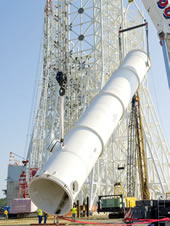 A 39,000-gallon water tank is lifted into place at the A-3 Test Stand construction site at Stennis Space Center.