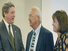 NASA's John C. Stennis Space Center Director Gene Goldman (left) visits with Meridian Community College.