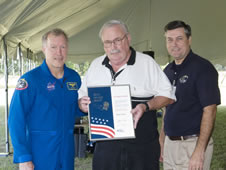 Astronaut Dominic Gorie (left) stands with Silver Snoopy recipient Clay Brown.