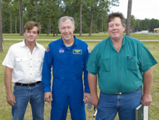 Astronaut Dominic Gorie (center) stands with Silver Snoopy recipients Jerry Knight and Dale Green.
