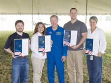 Astronaut Dominic Gorie (center) stands with Silver Snoopy recipients (l to r): Chris Coogan, Sherry Giveans, Nicholas Riesner, and Janine Cuevas.