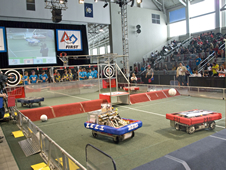 Student-built robots maneuver the course during the 2010 Bayou Regional FIRST Robotics competition in Westwego.