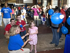 A young visitor to the Powerhouse Community Arts and Cultural Center in Oxford, Miss., enjoys a ballon rocket transportation activity during a NASA Night in the Neighborhood on March 29.