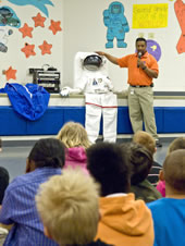 Alexia Harry assistant director of Astro Camp at NASA's John C. Stennis Space Center, talks with students at Lake Cormorant (Miss.) Elementary School during a