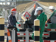 NASA John C. Stennis Space Center employee Dustan Ladner (left) assists tanker driver David Velasco in transferring RP-1 fuel to a 20,000-gallon underground tank at the E-1 Test Stand during a March 30 delivery.