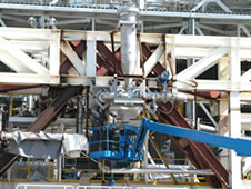 A pair of work crews at NASA's John C. Stennis Space Center continues modifications to the E-1 Test Stand on March 30 in preparation for testing Aerojet AJ26 rocket engines that Orbital Sciences Corporation will use to power commercial transport flights to the International Space Station.