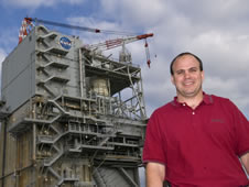David Roberts stands in front of the A-2 Test Stand at NASA's John C. Stennis Space Center.