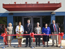 Stennis cuts ribbon on new Records Retention Facility.