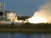 Fire and steam signal a successful test firing of Orbital Sciences Corporation's Aerojet AJ26 rocket engine at NASA's John C. Stennis Space Center.