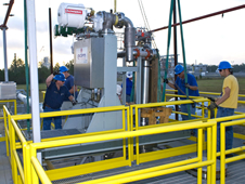 Stennis Space Center employees install a chemical steam generator unit at the E-2 Test Stand.