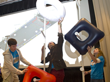 Chris Collins (l to r), Andy Zhou and Rachel Holladay from Northshore High School in Slidell place FIRST (For Inspiration and Recognition of Science and Technology) logo pieces during 2011 FIRST Robotics Competition.