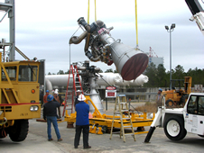 Stennis Space Center employees monitor the lifting of the first Aerojet AJ26 flight engine at the E-1 Test Stand onsite.