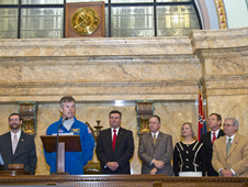 Astronaut Steven Swanson (front) speaks to members of the Mississippi House of Representatives in chambers during NASA Day at the Capitol.