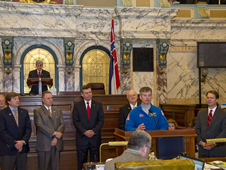 Astronaut Steven Swanson (front) speaks to members of the Mississippi Senate in chambers during NASA Day at the Capitol.