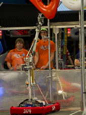 Members of the robotics team from Gulfport High School focus on guiding their robot on the 2011 Bayou Regional playing field during the annual FIRST Robotics Competition.