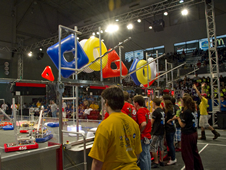 Student-built robots maneuver the course during the 2011 Bayou Regional FIRST Robotics competition.