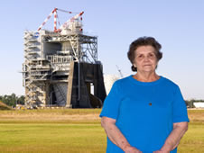 Jeanne Kellar stands in front of the A-2 Test Stand at Stennis Space Center, where she has worked for 45 years.