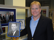 "Jackson ""Jack"" Balch Jr. poses with a photo of his father, Jackson Balch Sr., who served as second site manager for 10 years at Mississippi Test Facility."