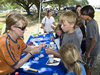 Kids crowd an activity table during the 50th Anniversary Open House sponsored by John C. Stennis Space Center.