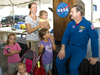Astronaut Scott Altman talks with guests during a 50th Anniversary Open House activity at John C. Stennis Space Center.