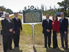 SSC Director Patrick Scheuermann (second from left) stands at the historical marker erected by the state of Mississippi honoring SSC's 50th anniversary.