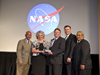 NASA's Administrator Charles Bolden (l) and Glenn Delgado (r) present Small Business Administrator's Award to SSC.