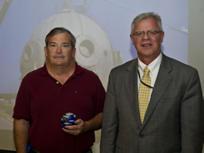NASA Environmental Management Director James Leatherwood (right) presents the NASA Environmental Quality Award to Bryon Maynard at SSC.