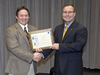SSC Director Rick Gilbrech presents the 2012 Contractor Excellence Award to Mike McDaniel, general manager for Pratt & Whitney Rocketdyne.