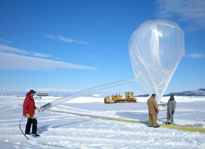 A balloon in Antarctica is filled in preparation for launch.