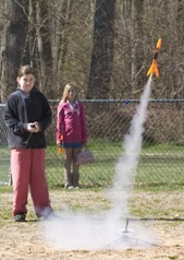 Victoria Rose (left) launches her model rocket while Alyson Hickman waits for a turn on the launcher.