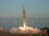 A Terrier-Orion rocket with student tests aboard rises from a luminous cloud of smoke