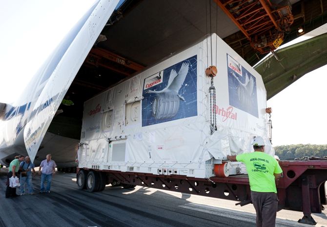 The Cygnus payload is unloaded from a cargo plane at Wallops