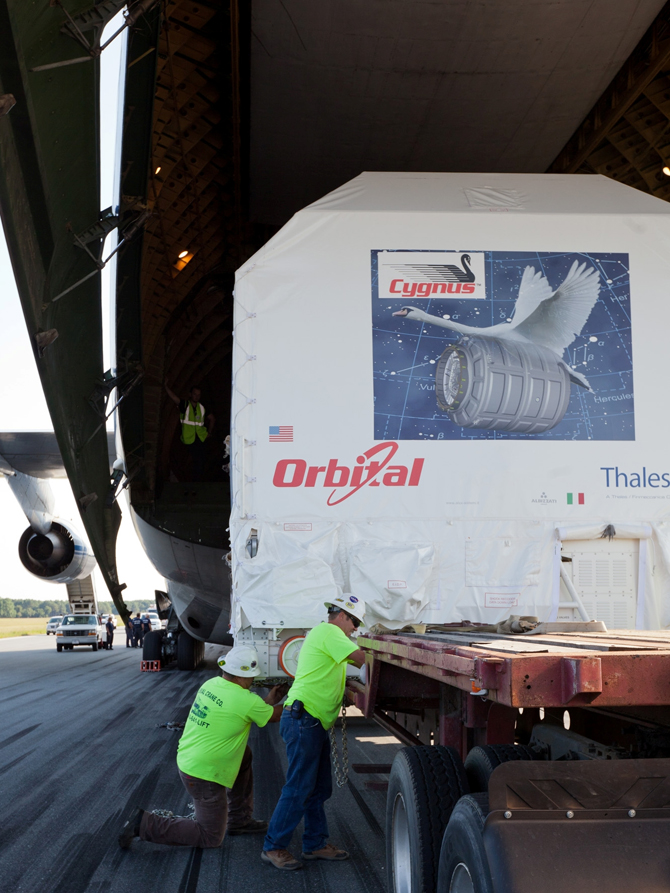 The Cygnus payload in the belly of a cargo plane at Wallops (closeup)
