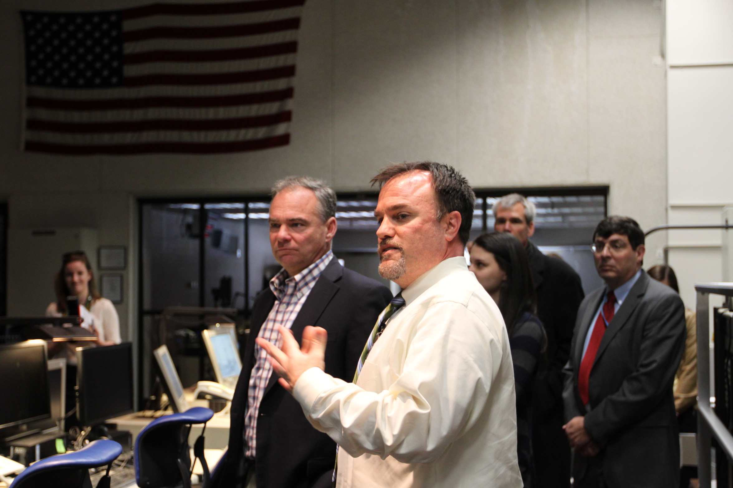 Virginia Senator Tim Kaine receives an overview of the Wallops Range Control Center from Range Deputy Chief Steve Kremer.