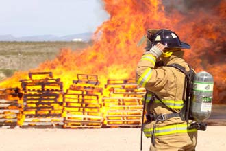 A NASA WSTF Firefighter trains during Fire Prevention Week
