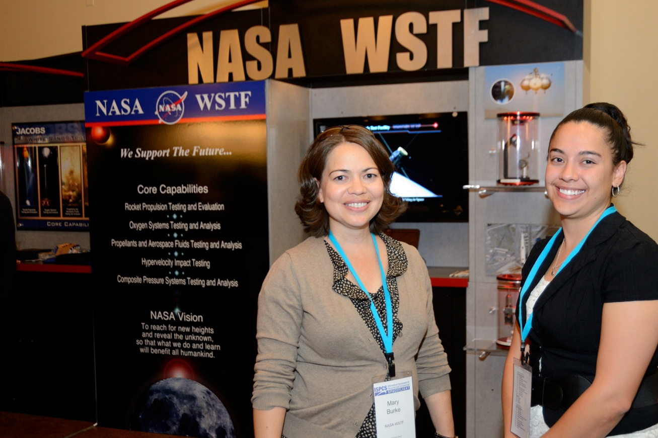 NASA's Mary Burke and Christina Piña Arpin at the NASA WSTF exhibit at ISPCS
