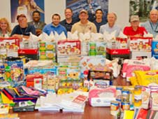 ERC employees and their food contributions, which also included back-to-school items. WSTF0812e09787 (Reed Elliott)