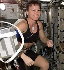 Astronaut Peggy Whitson works out onboard the International Space Station.
